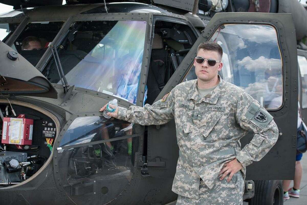 Army Army Reserve Warrant Officer Benjamin M. Ciraulo takes a break from flying a Blackhawk helicopter.