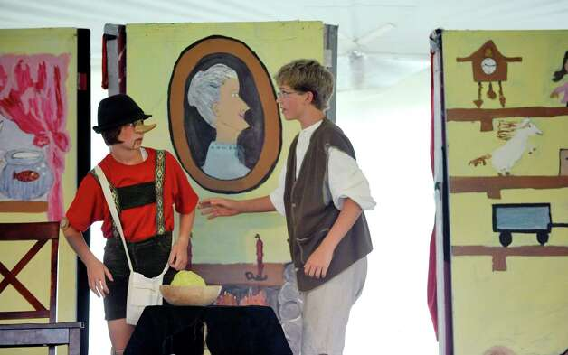 Isabel Witzenburg, left, plays the part of Pinocchio and Benjamin Drzymala plays the part of Gepetto during a production of a variation of Pinocchio as part of the Classic Theater Guild Helderberg Theater Festival at  Indian Ladder Farms on Sunday, July 27, 2014, in Voorheesville, N.Y.  A cast of 35 children take part in the production, which will have one final showing on August 2nd at Proctors.  An adult cast will also perform A Midsummer Night's Dream following Pinocchio.  The children began rehearsals in June and had their first show last weekend.  The play was directed by middle school students,  Stephanie DeFronzo, Jaynie Parmenter, and Noah Robinson. (Paul Buckowski / Times Union) Photo: Paul Buckowski / 00027954A