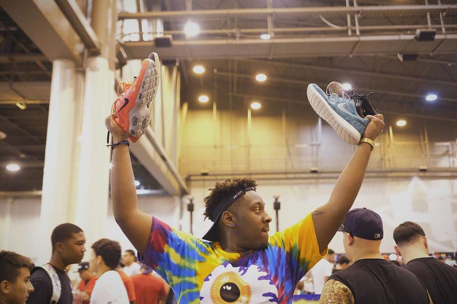 Jamarai Nelson looks to sell sneakers during the 2014 H-Town Sneaker Summit on Sunday at NRG Park. The event has grown to host thousands of people since its inception in 2004. Photo: Â TODD SPOTH, 2014 / © TODD SPOTH, 2014