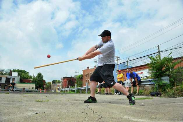 "Jason DeFazio, playing for Team DeFazio, gets a hit in their game against Team Money during the Stick it to Hunger sixth annual stick ball tournament on Sunday, July 27, 2014, in Troy, N.Y.  The event is put on by the Friends of Little Italy and the DeFazio Family.  Teams playing in the games bring food items to donate to Joseph's House and Shelter in Troy.  Rocco DeFazio, owner of DeFazio's Pizza, said that the event began as a way to raise awareness and to help feed the children in homeless families.  ""We're playing a kids game, stickball, to help take care of children"" DeFazio said.  Last years event brought in $14,000 in donated food for Joseph's House.  Kevin O'Connor, executive director of Joseph's House said that they rely on donations to feed the families they support and that with out donations like this they couldn't meet the need.  (Paul Buckowski / Times Union) Photo: Paul Buckowski / 00027897A"