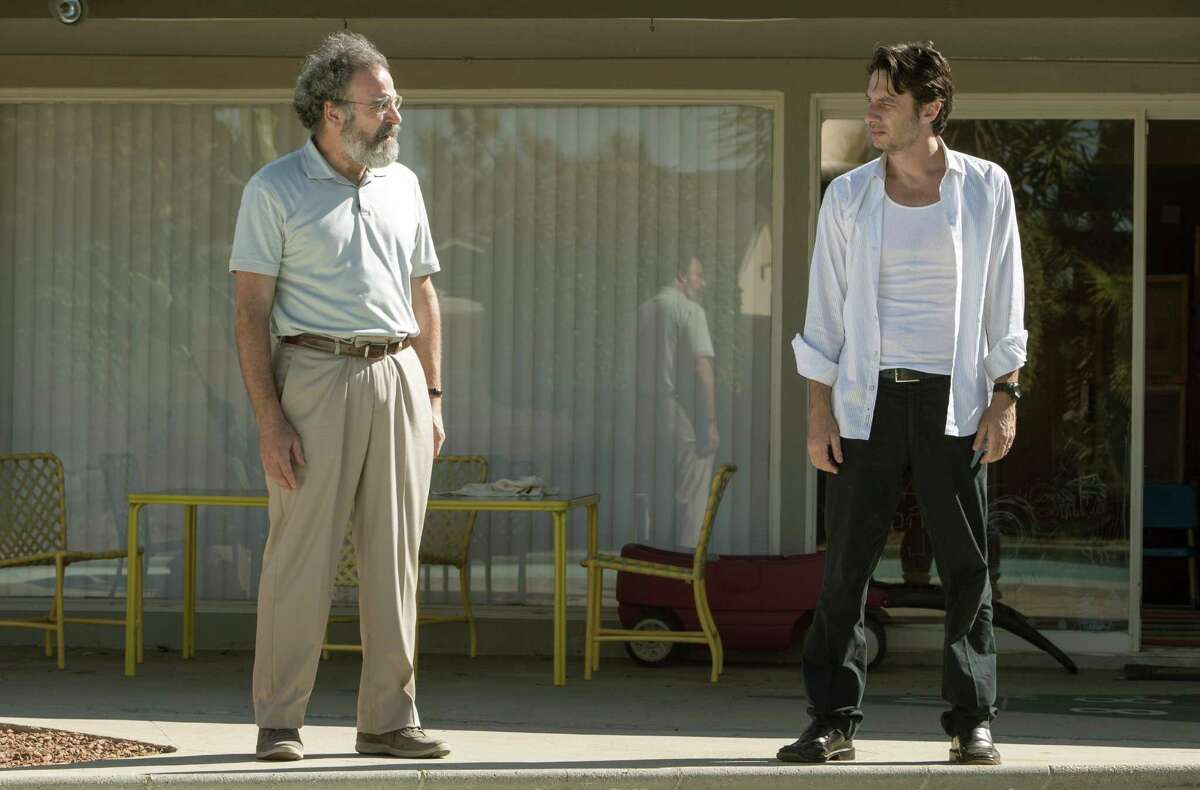 This image released by Focus Features shows Mandy Patinkin, left, and Zach Braff in