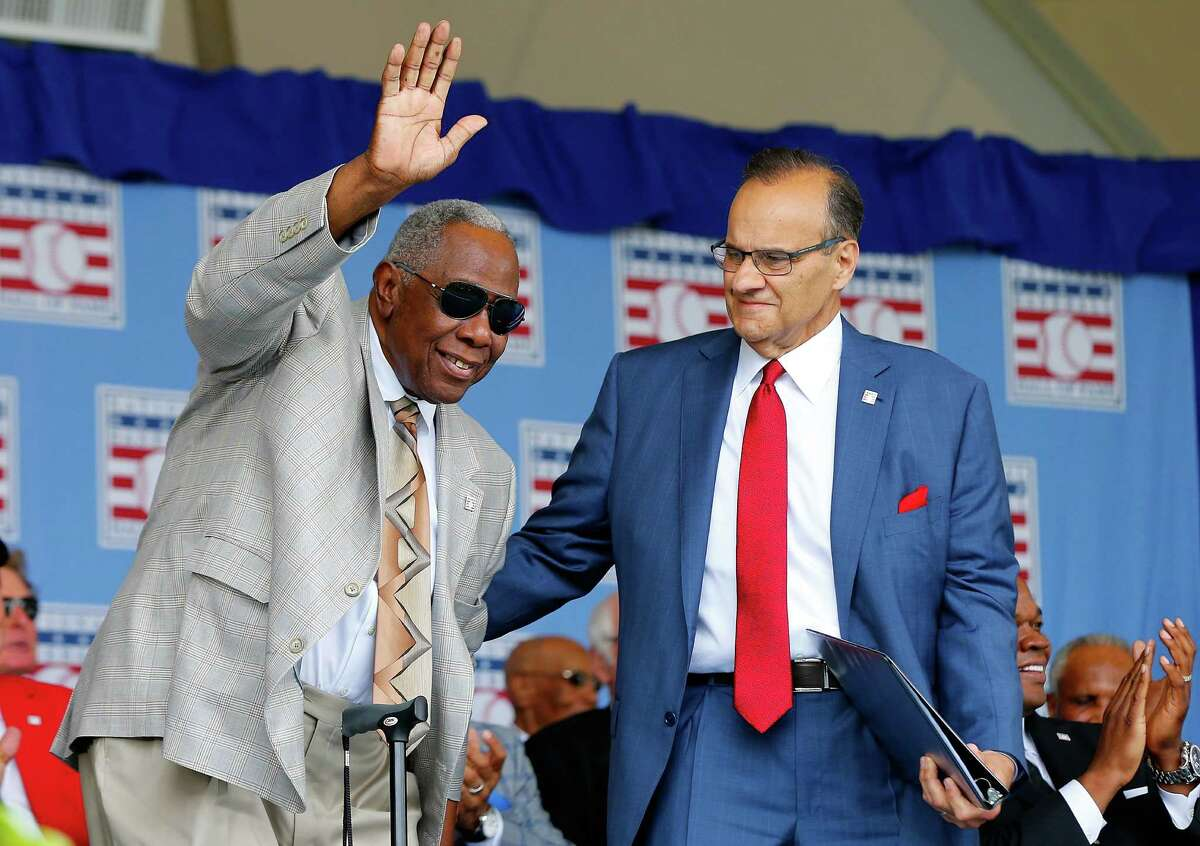 COOPERSTOWN, NY - JULY 27: Inductee Joe Torre assists baseball legend and Hall of Famer Hank Aaron as he is intoduced at Clark Sports Center during the Baseball Hall of Fame induction ceremony on July 27, 2014 in Cooperstown, New York. (Photo by Jim McIsaac/Getty Images) ORG XMIT: 503427155