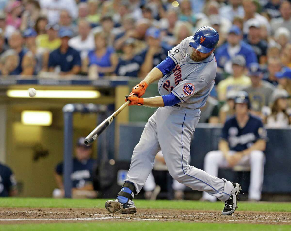 New York Mets' Lucas Duda hits a two-run home run against the Milwaukee Brewers during the sixth inning of a baseball game Sunday, July 27, 2014, in Milwaukee. (AP Photo/Jeffrey Phelps) ORG XMIT: WIJP109