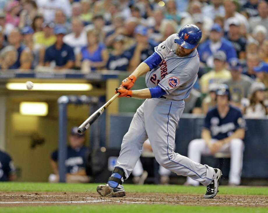 New York Mets' Lucas Duda hits a two-run home run against the Milwaukee Brewers during the sixth inning of a baseball game Sunday, July 27, 2014, in Milwaukee. (AP Photo/Jeffrey Phelps)  ORG XMIT: WIJP109 Photo: Jeffrey Phelps / FR59249 AP