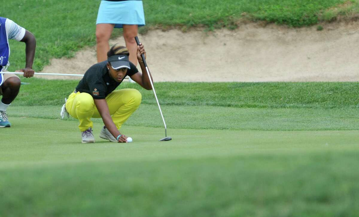 Sadena Parks places her ball on the 18th green during the final round of the SEFCU Championship, a Symetra Tournament, at Capital Hills golf course on Sunday, July 27, 2014, in Albany, N.Y. (Paul Buckowski / Times Union)