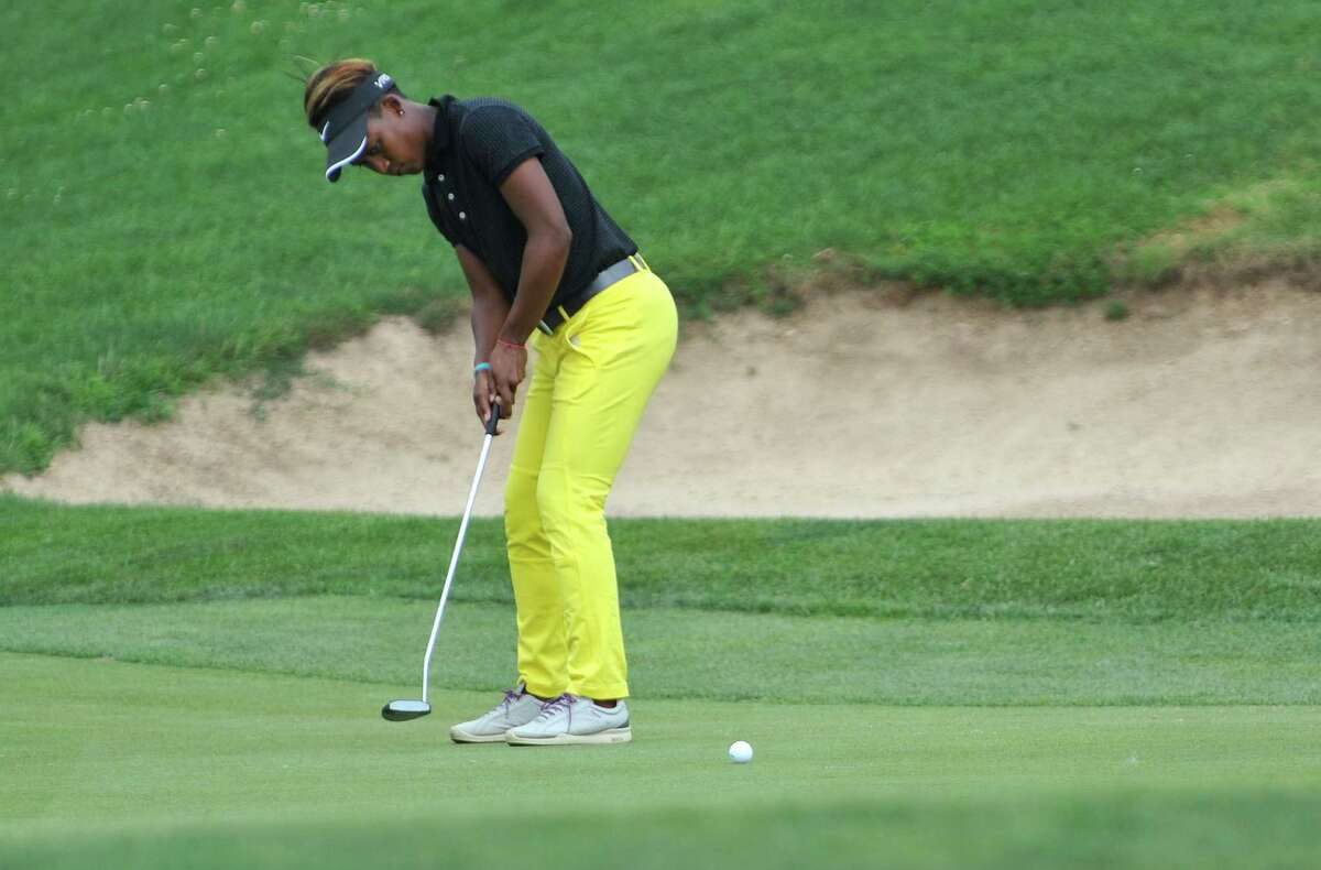 Sadena Parks sinks a putt on the 18th green during the final round of the SEFCU Championship, a Symetra Tournament, at Capital Hills golf course on Sunday, July 27, 2014, in Albany, N.Y. (Paul Buckowski / Times Union)
