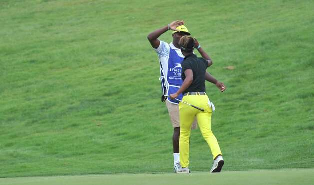 Sadena Parks celebrates with her caddy after sinking a putt on the 18th green during the final round of the  SEFCU Championship, a Symetra Tournament, at Capital Hills golf course on Sunday, July 27, 2014, in Albany, N.Y.  (Paul Buckowski / Times Union) Photo: Paul Buckowski / 00027892C