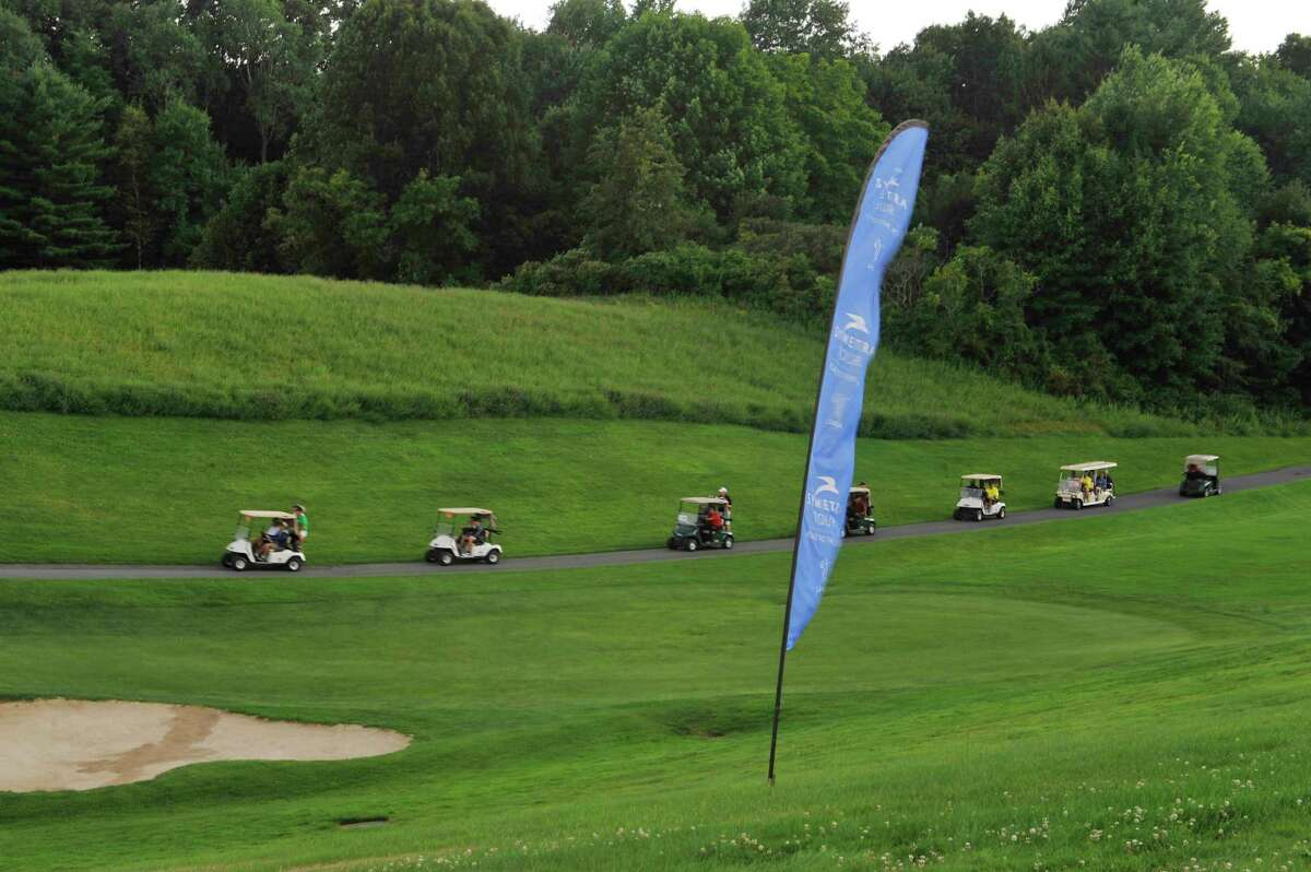Golf carts with players head back to the clubhouse when play was suspended due to lightning during the final round of the SEFCU Championship, a Symetra Tournament, at Capital Hills golf course on Sunday, July 27, 2014, in Albany, N.Y. (Paul Buckowski / Times Union)