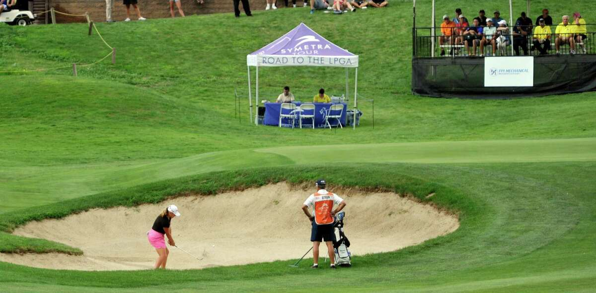Marissa Steen hits out of a sand trap on the 18th hole during the final round of the SEFCU Championship, a Symetra Tournament, at Capital Hills golf course on Sunday, July 27, 2014, in Albany, N.Y. (Paul Buckowski / Times Union)