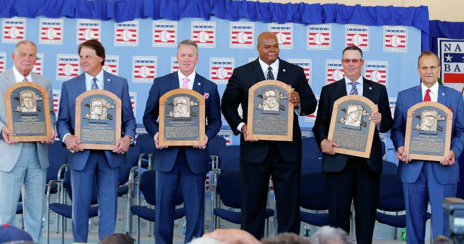 COOPERSTOWN, NY - JULY 27:  Inductees, from left, Bobby Cox, Tony La Russa, Tom Glavine, Frank Thomas, Greg Maddux and Joe Torre pose with their plaques at Clark Sports Center during the Baseball Hall of Fame induction ceremony on July 27, 2014 in Cooperstown, New York.  Glavine won 305 games and two National League Cy Young awards during his 22 year career. Maddux won 355 games and four consecutive National League Cy Young awards (1992-95) during his 23 year career. Thomas hit 521 home runs and won two American League Most Valuable Player awards during his 19 year career. Cox managed for 29 seasons with 2,504 victories and won five National League pennants and the 1995 World Series with the Atlanta Braves. La Russa managed for 33 seasons with 2,728 victories and led his teams to six pennants and three Worls Series titles. Torre managed for 29 seasons with 2,326 victories and led the New York Yankees to six American League pennants and four World Series titles.  (Photo by Jim McIsaac/Getty Images) ORG XMIT: 503427155 Photo: Jim McIsaac / 2014 Getty Images