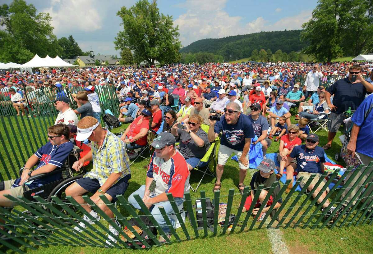 Baseball fans applaud during the Induction Ceremony during the Hall of Fame Weekend at the Clark Sports Center, Sunday, July 27, 2014 in Cooperstown, N.Y. (AP Photo/Observer-Dispatch, Mark DiOrio) ORG XMIT: NYUTI106