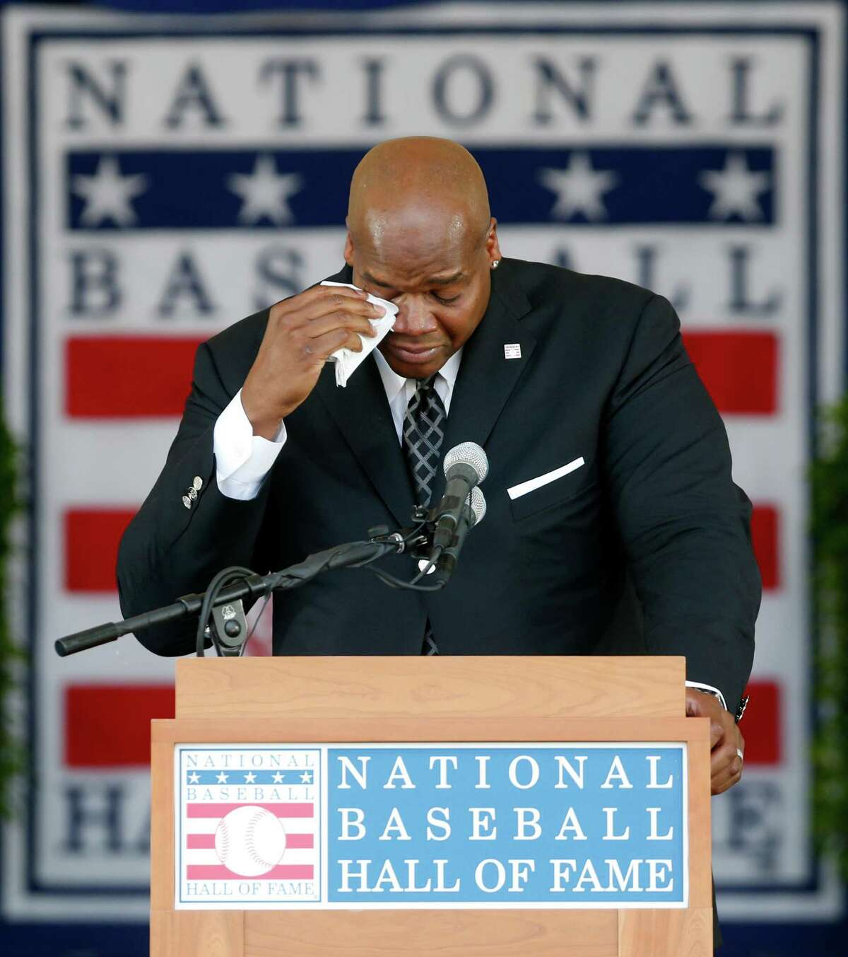 National Baseball Hall of Fame inductee Frank Thomas gets emotional as he speaks during an induction ceremony at the Clark Sports Center on Sunday, July 27, 2014, in Cooperstown, N.Y. (AP Photo/Mike Groll) ORG XMIT: NYMG115