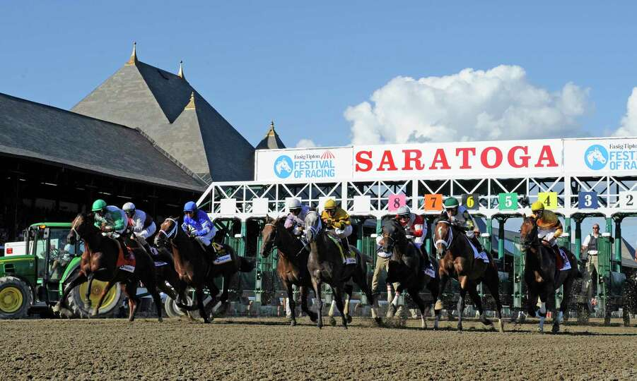 The field breaks from the gate in the 86th running of The Whitney Invitational Aug. 3, 2013, at the