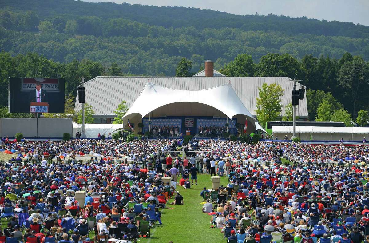 Baseball fans attend the Hall of Fame Weekend Induction Ceremony at the Clark Sports Center, Sunday, July 27, 2014 in Cooperstown, N.Y. (AP Photo/Observer-Dispatch, Mark DiOrio) ORG XMIT: NYUTI110
