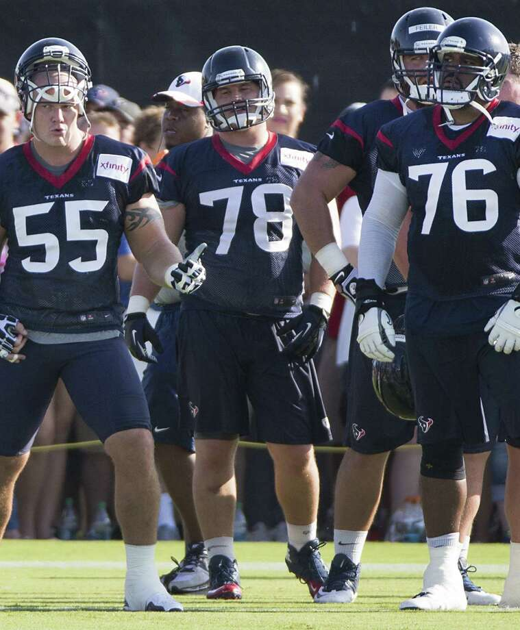 Texans linemen Chris Myers (55) and Duane Brown (76) are dedicating the 2014 season to linemate David Quessenberry, who is battling cancer. Photo: Brett Coomer / Houston Chronicle / © 2014 Houston Chronicle