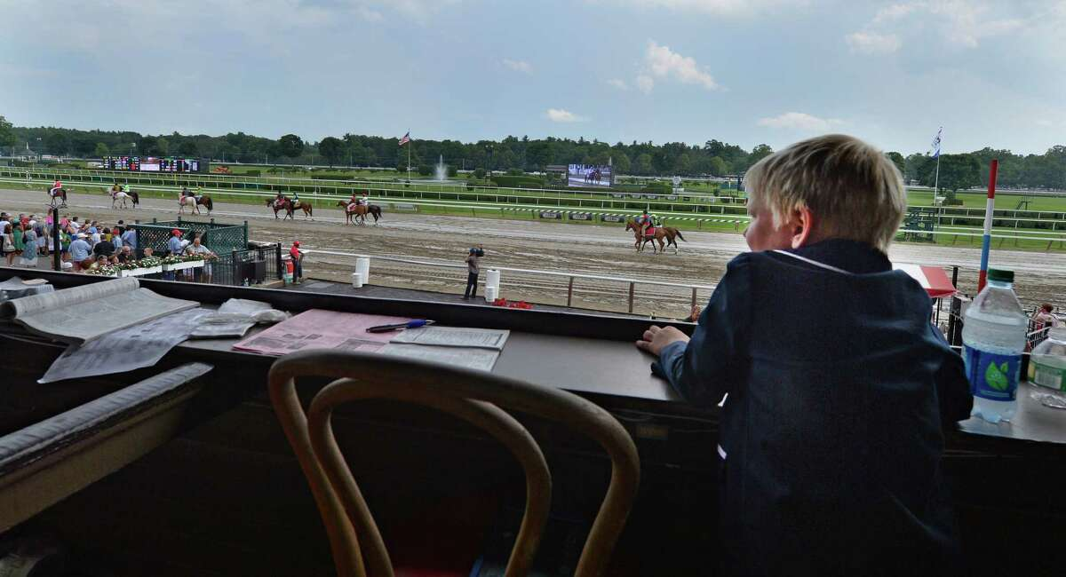 Aston Ferrillo, 6, of Saratoga Springs looks over the field in the third race on the card Sunday afternoon July 27, 2014 at the Saratoga Race Course in Saratoga Springs, N.Y. (Skip Dickstein / Times Union)
