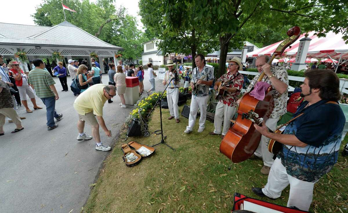 The Upstate Bluegrass Band welcomes race patrons to the track Sunday afternoon July 27, 2014 at the Saratoga Race Course in Saratoga Springs, N.Y. (Skip Dickstein / Times Union)