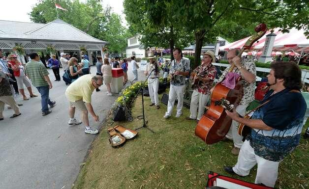 The Upstate Bluegrass Band welcomes race patrons to the track Sunday afternoon July 27, 2014 at the Saratoga Race Course in Saratoga Springs, N.Y.    (Skip Dickstein / Times Union) Photo: SKIP DICKSTEIN