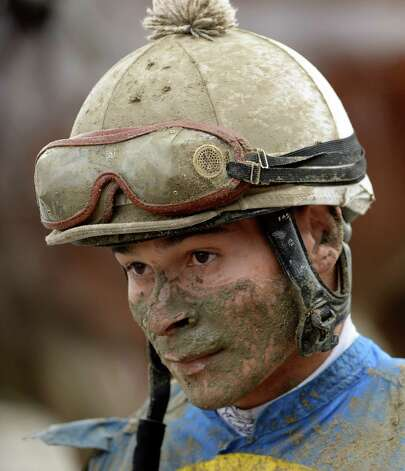 Jockey Abel Lezcano, covered with mud, shows the results of finishing out of the money in the 7th race Sunday afternoon July 27, 2014 at the Saratoga Race Course in Saratoga Springs, N.Y.    (Skip Dickstein / Times Union) Photo: SKIP DICKSTEIN