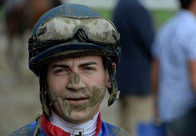 Jockey Brian Hernandez shows the effects of running in the back of the pack on the muddy surface in the featured race of the day, The Shuvee Sunday afternoon July 27, 2014 at the Saratoga Race Course in Saratoga Springs, N.Y.    (Skip Dickstein / Times Union) Photo: SKIP DICKSTEIN