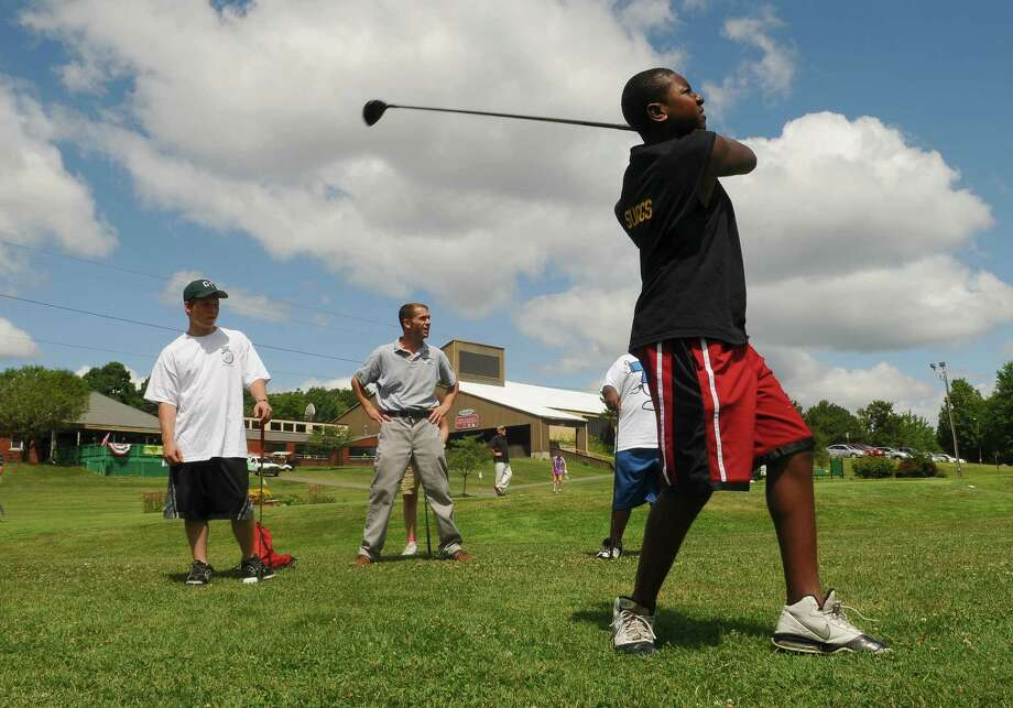 Kiel Suggs of Troy, 15, hits a practice shot during Hook A Kid on Golf at the Frear Park Municipal Golf Course on Wednesday morning July 27, 2011 in Troy, NY.  The free golf instruction camp runs during the week in the morning, except for this Friday, and will continue next week. The camp is sponsored by the City of Troy and several local sponsors. (Philip Kamrass / Times Union) Photo: Philip Kamrass / 00014042A