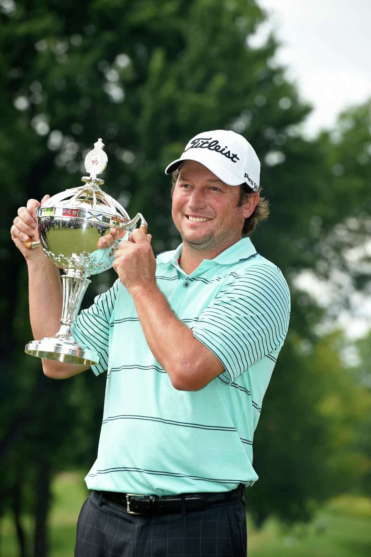 MONTREAL, QC - JULY 27: Tim Clark of South Africa holds the trophy after winning the RBC Canadian Open at the Royal Montreal Golf Club on July 27, 2014 in Montreal, Quebec, Canada. (Photo by Charles Laberge/Getty Images) ORG XMIT: 461900033