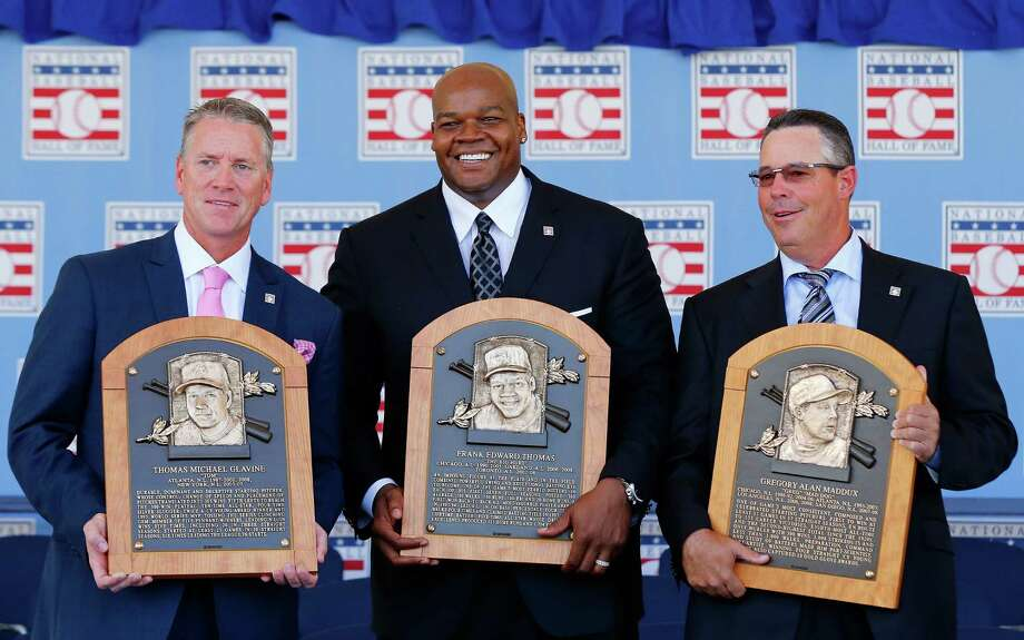 Tom Glavine (from left), Frank Thomas and Greg Maddux display their Hall of Fame plaques at the induction ceremony. Photo: Jim McIsaac / Getty Images / 2014 Getty Images
