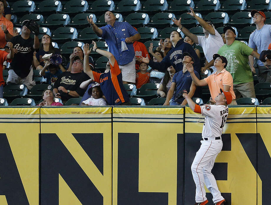 Marc Krauss can't reach a home run hit by Miami's Garrett Jones during the first inning. The Marlins swept the Astros in Houston for the first time. Photo: Karen Warren / Houston Chronicle / © 2014 Houston Chronicle