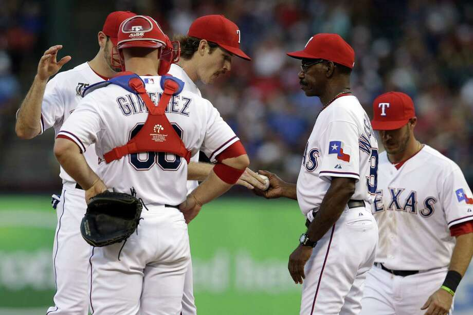 Miles Mikolas hands the ball to Rangers manager Ron Washington after a rough outing in Arlington. Photo: Tony Gutierrez / Associated Press / AP