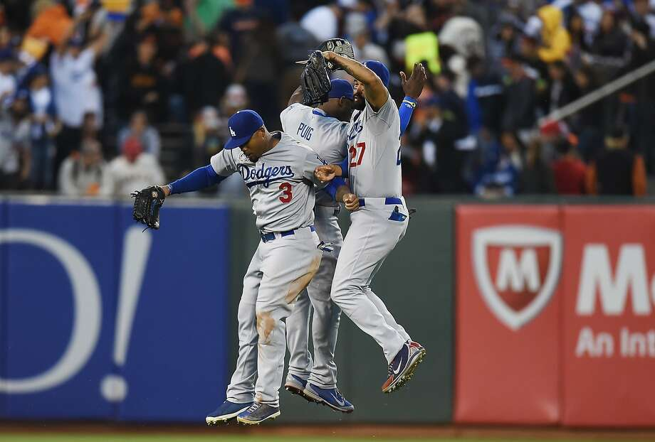 Outfielders Carl Crawford (left), Yasiel Puig and Matt Kemp celebrate the Dodgers' three-game sweep at AT&T Park. Photo: Thearon W. Henderson, Getty Images