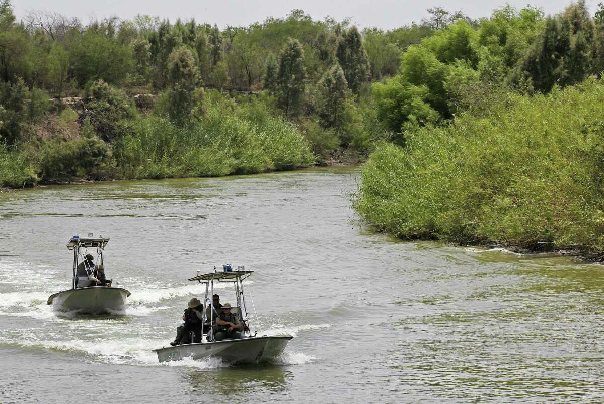 Border Patrol boats ride in the Rio Grande along Hidalgo County, which has dealt with the lion's share of the recent surge in immigrants from Central America.
