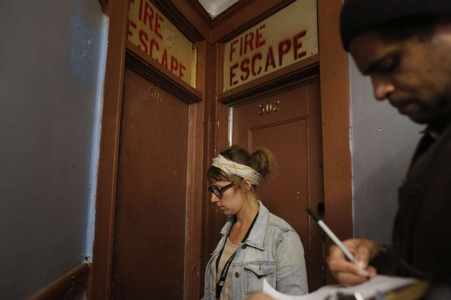 Checking for a potential code violations, Community Organizer with the Central City SRO Collaborative Karin Drucker with tenant organizer JC Castle knock on doors inside the The Ellis Hotel in San Francisco, Calif. Photo: Mike Kepka