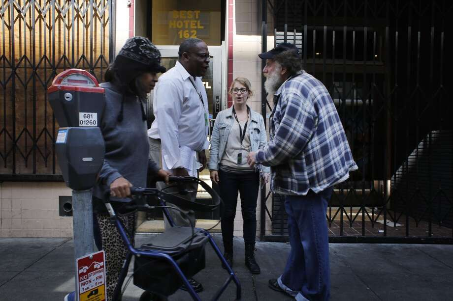 After meeting tenant in The Best Hotel,  Karin Drucker, Community Organizer with the Central City SRO Collaborative and Tenant Organizer Reggie Reed cross paths with residents of the Tenderloin in San Francisco, Calif. Photo: Mike Kepka