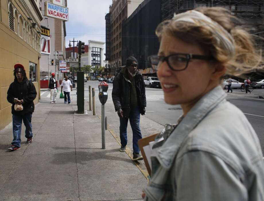 Community Organizer with the Central City SRO Collaborative Karin Drucker walks back to the office in the Tenderloin after an afternoon of SRO tenant outreach in San Francisco, Calif. Photo: Mike Kepka
