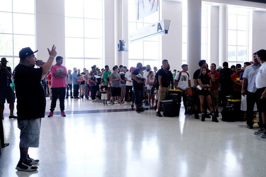 DJ Tito of Sneaker Summit speaks to the gathered line of attendees, during the 2014 H-Town Sneaker Summit, Sunday, July 27, 2014 at NRG Park in Houston, Texas. Photo: © TODD SPOTH, 2014