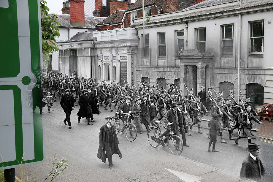 In this digital composite image a comparison has been made of Royal Tunbridge Wells during World War I and modern day 2014: Departure of the Liverpool Scottish Regiment for the front from Royal Tunbridge Wells at the start of World War One, circa November 1914. Photo: Popperfoto, Popperfoto/Getty Images / Popperfoto