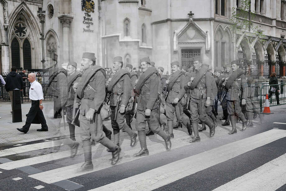 In this digital composite image a comparison has been made of London during World War I and modern day 2014: Serbian soldiers marching in the Lord Mayor's show, London in the last days of WW I 9th November 1918. Photo: Peter Macdiarmid, Getty Images / 2014 Getty Images