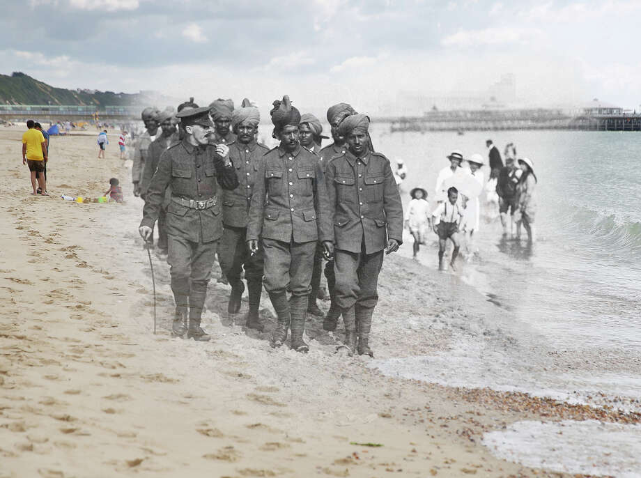 In this digital composite image a comparison has been made of Bournemouth during World War I and modern day 2014: Indian soldiers who were wounded fighting at Flanders recuperating at Bournemouth in England, Bournemouth, England, circa 1917. Photo: Underwood Archives, Getty Images / Archive Photos