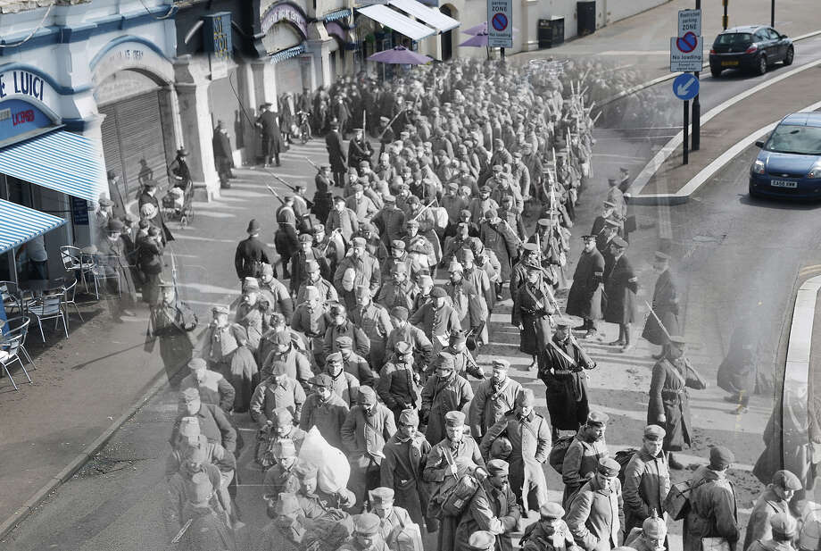 In this digital composite image a comparison has been made of Southend on Sea during World War I and modern day 2014:  German prisoners of war during the First World War on their way to Southend Pier accompanied by guards and watched by the local populace. Photo: Peter Macdiarmid, Getty Images / 2014 Getty Images