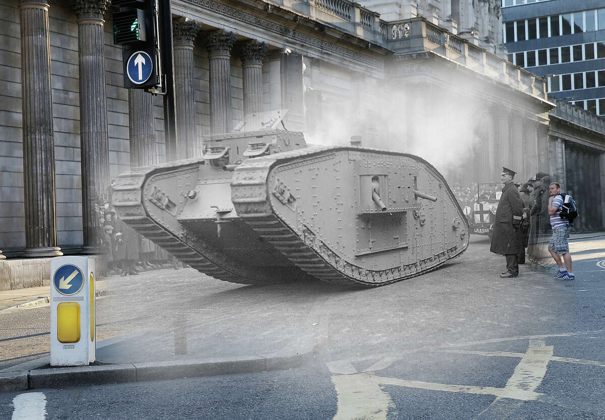 In this digital composite image a comparison has been made of London during World War I and modern day 2014: Early morning light at the Bank of England on July 17, 2014 in The City of London.