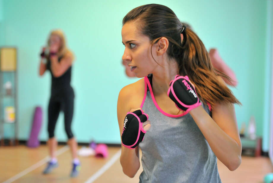 Gaby Lobo works out in a Piloxing class recently at inBalance San Antonio Studio near I10 and Leon Springs Rd. Photo: Robin Jerstad