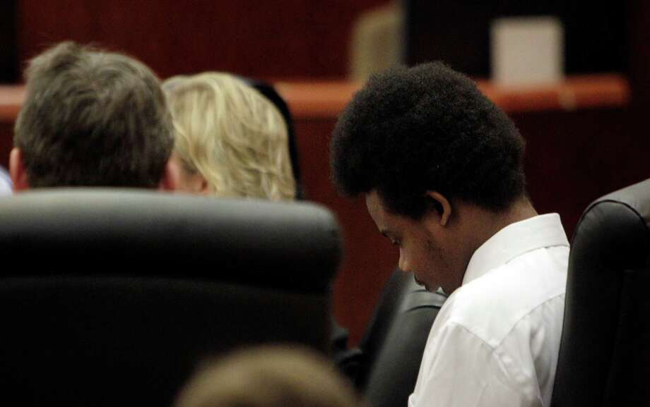 Defendant Harlem Lewis listens to the prosecutors during closing arguments in his death penalty case in the 351st District Court at the Harris County Criminal Courthouse on Monday, July 28, 2014, in Houston. Photo: Mayra Beltran, Houston Chronicle / © 2014 Houston Chronicle