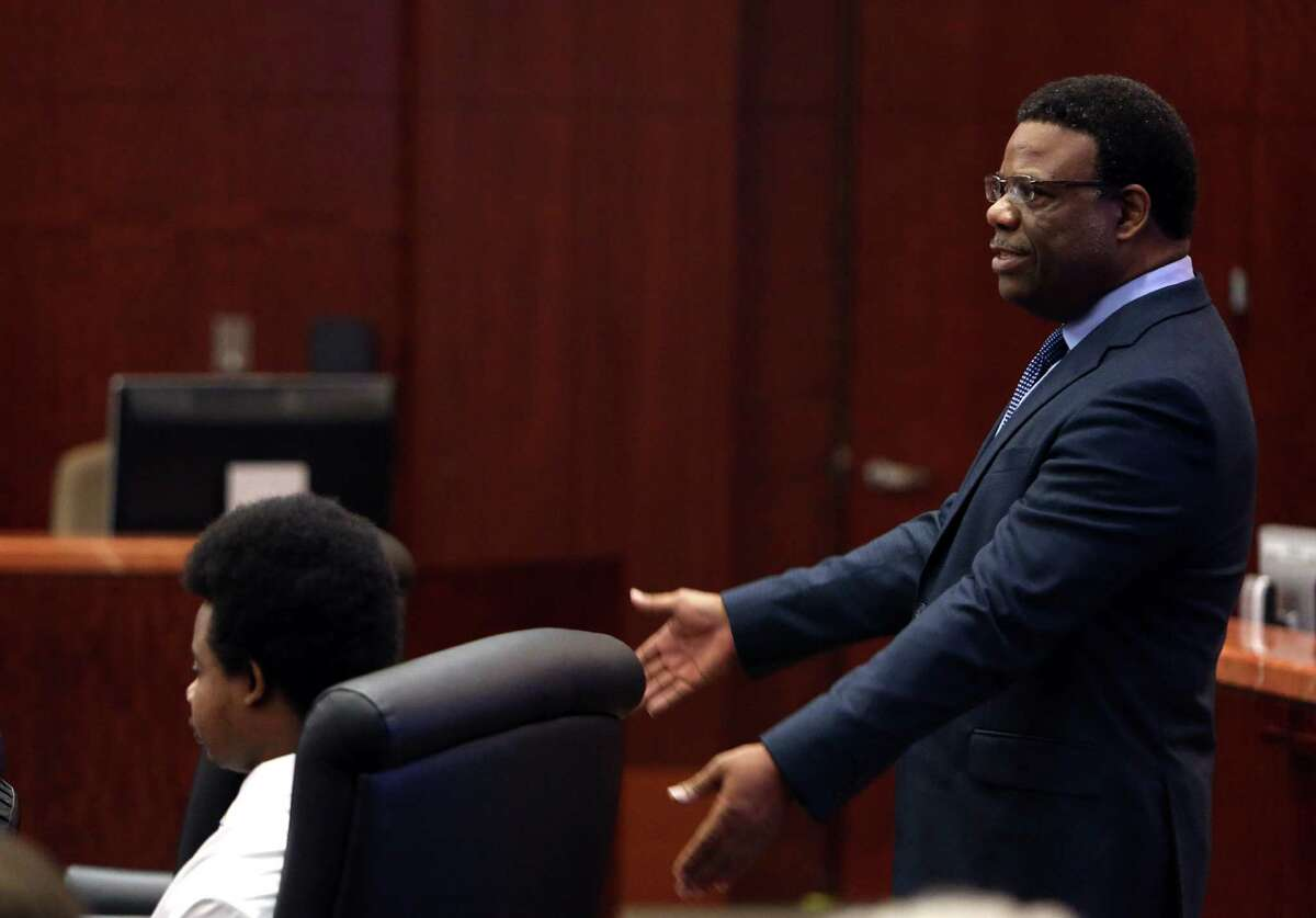 Lawyer Tyrone Moncriffe stands behind defendant while delivering his closing arguments in a death penalty case in 2014. Moncriffe is representing Corey Coleman in an ongoing murder case in Fort Bend County.