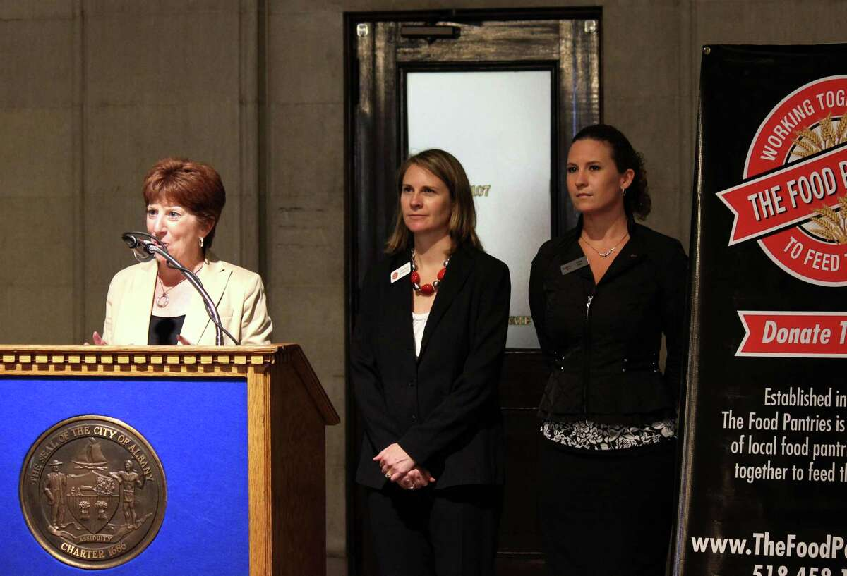 Albany Mayor Kathy Sheehan, left, Food Pantries executive director Natasha Pernicka, and KeyBank director of community relations and vice president Kate Otis, right, announced a collaborative city-wide food drive in recognition of the Food Pantries for the Capital District's 35 years serving the community on Monday, July 28, 2014, in Albany N.Y. The food drives runs through August 8. (Selby Smith/Special to the Times Union)