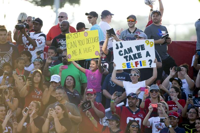 Day 3: July 28  Texans fans cheer as defensive end J.J. Watt runs o