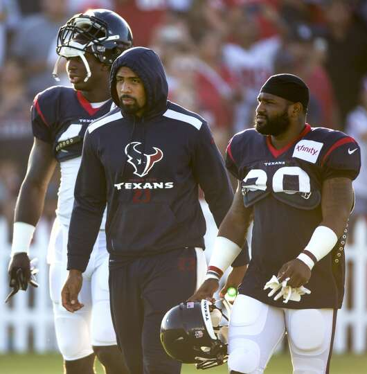 Day 3: July 28  Running back Arian Foster, center, walks onto the f