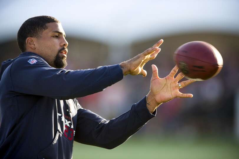 Day 3: July 28  Texans running back Arian Foster reaches out to cat