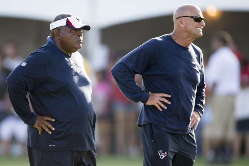 Day 3: July 28  Texans defensive coordinator Romeo Crennel, left, a