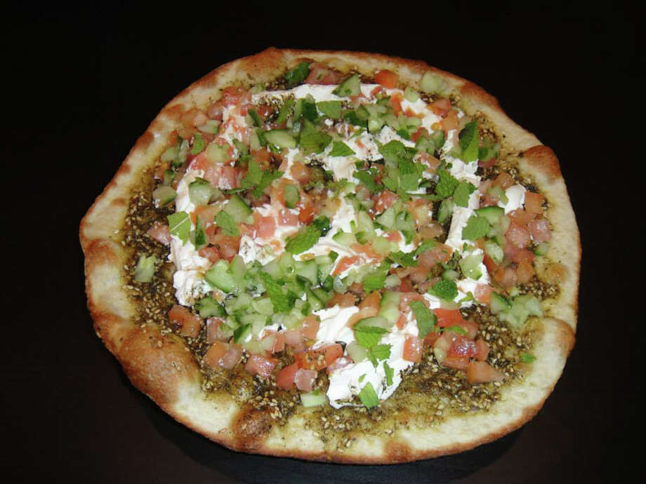 Wild Oregano Flatbread at Kibberia Restaurant in Westport, Conn. Photo: Contributed Photo / Connecticut Post Contributed