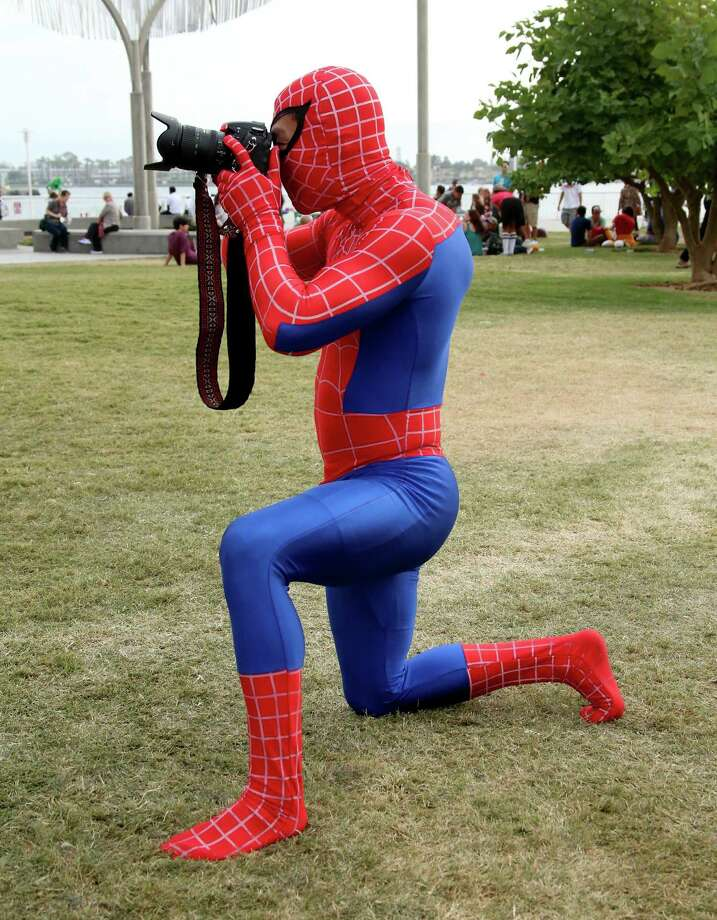 Spiderman 1Spandex? Check. Face mask? Check. Camera? Check...wait, you aren't supposed to photograph the crime, you're supposed to fight it.  Photo: Mark Davis, Getty / 2014 Getty Images